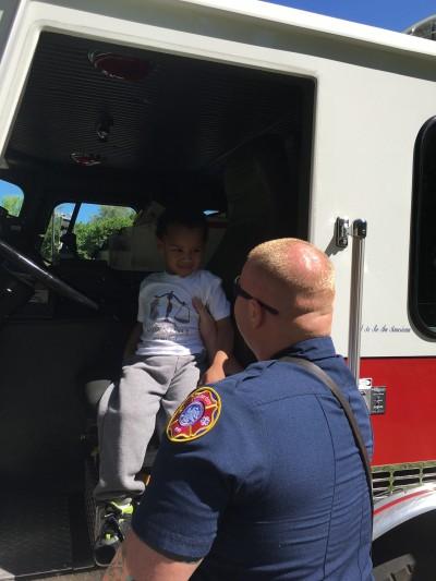 Kayden in firetruck